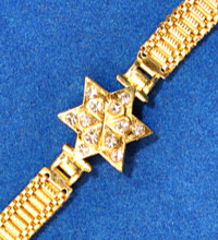 Golden Rakhi Bracelet with Star Shaped Design