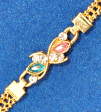 Golden Rakhi Bracelet with Colorful Stones