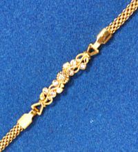 Golden Rakhi with White Stones