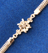 Silver Colored Rakhi with White Stones